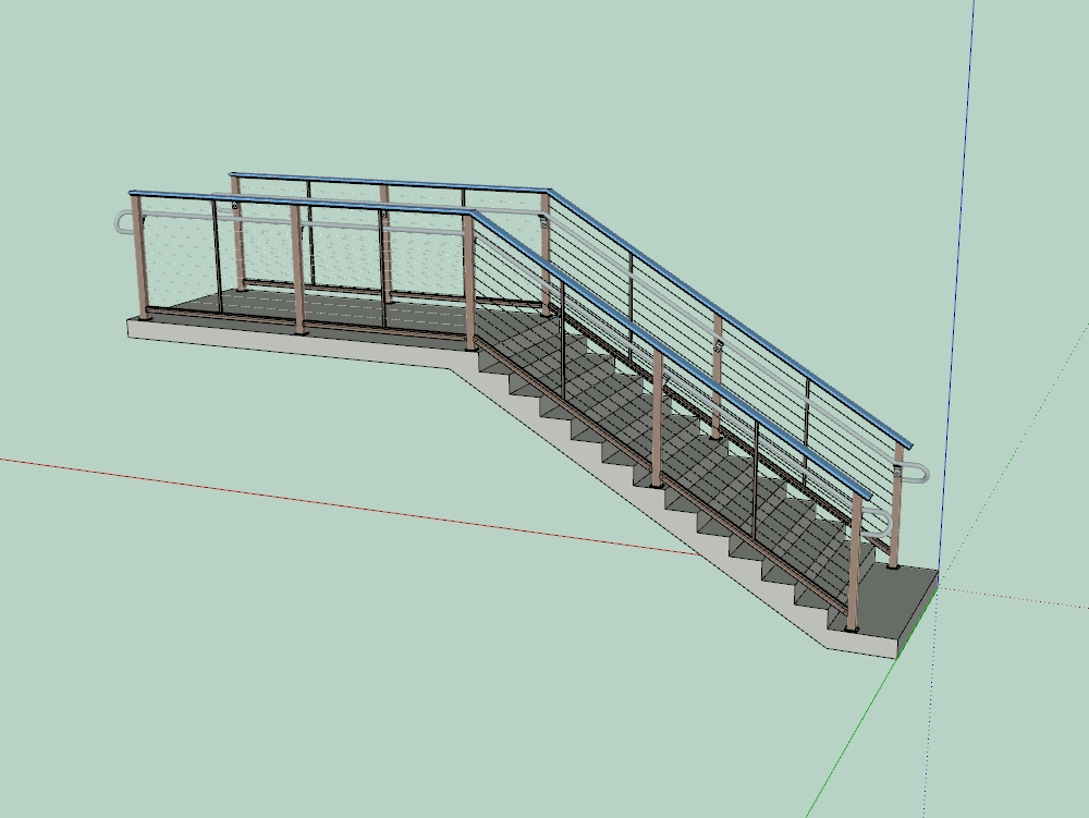 Escalera de concreto con baranda metálica y de aluminio